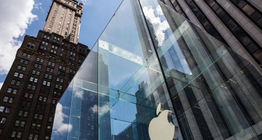 """NEW YORK, NY - AUGUST 05:  The Aple logo hangs on the Apple Store on Fifth Avenue on August 5, 2015 in New York City. Analysts at Bank of America Merrill Lynch recently changed their recommendation for Apple stock from """"buy"""" to """"neutral,"""" and lowered their target share price from $142 to $130.  (Photo by Andrew Burton/Getty Images)"""